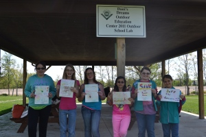 troop 924 members with endangered animal posters