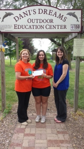 Christina Harkleroad, center, begins her internship as coordinator at Dani's Dreams Outdoor Education Center. Director Donna Griffin receives a grant from Kara Harrison of the Hancock County Community Foundation for Dani's Dreams Internship Program.